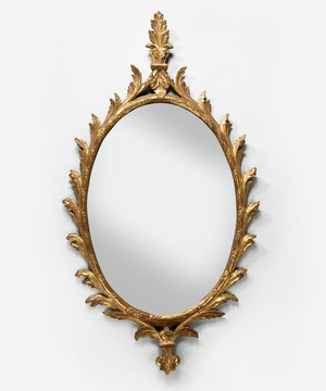 A George III Chippendale giltwood oval mirror.
