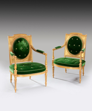 A fine pair of giltwood late 18th Century salon chairs .
