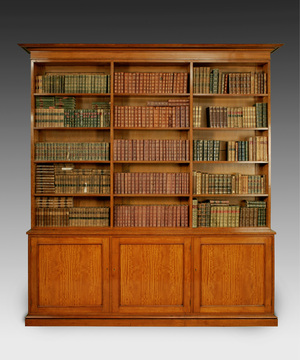 A Regency period satinwood open bookcase.
