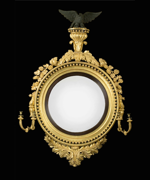 A Regency period giltwood convex mirror of unusually large scale.