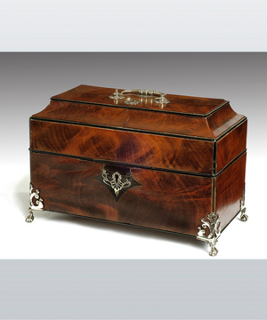 A fine Chippendale period mahogany caddy retaining its original silver canisters.