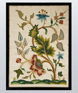 Eighteenth Century crewelwork of plants and flowers.