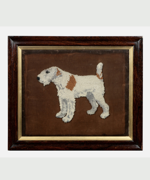 A 19th Century woolwork picture of a Fox Terrier.