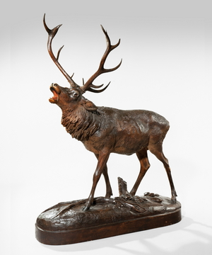 A Black Forest carved limewood stag.
