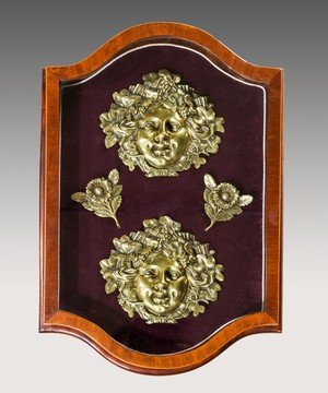 A pair of ormolu bacchic masks.