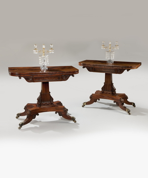 A superbly carved pair of Regency period mahogany tea tables.