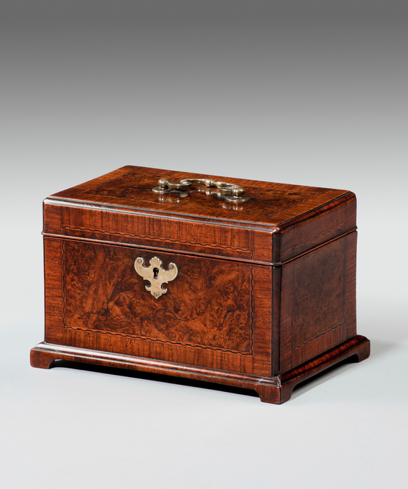 A George II walnut tea caddy.