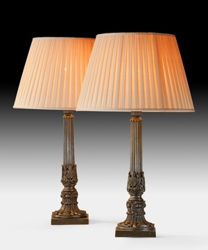 A fine pair of early Nineteenth Century bronze lamps.