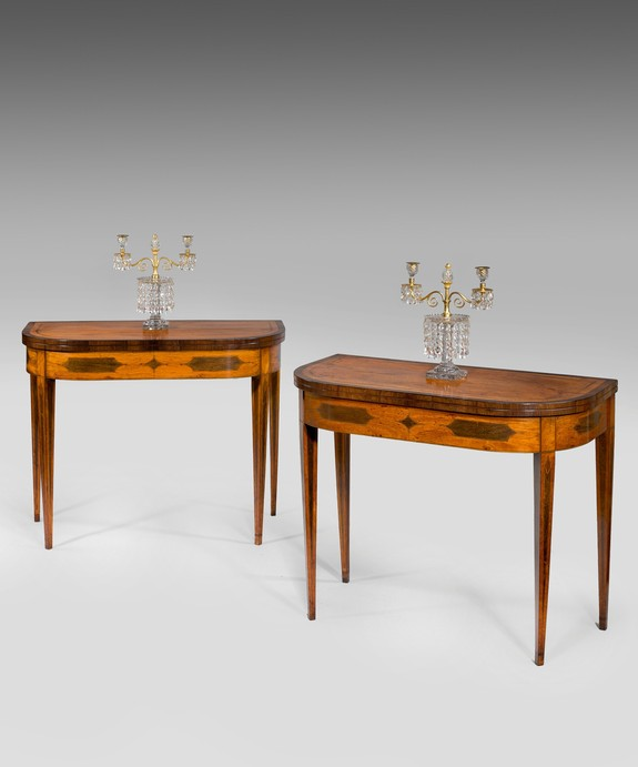 A pair of Sheraton card tables veneered in satinwood.
