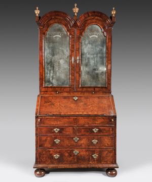A William and Mary period walnut veneered double domed bureau bookcase.