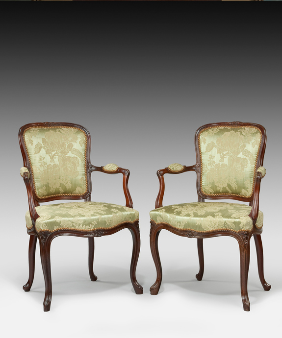 A pair of antique Hepplewhite salon armchairs.