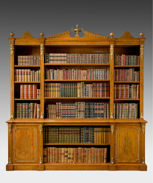 An important 19th century satinwood veneered open fronted breakfront bookcase.
