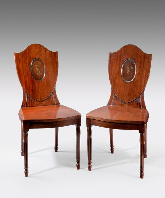 A pair of Hepplewhite hall chairs.
