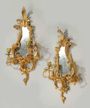 A pair of Chippendale style girandole mirrors.