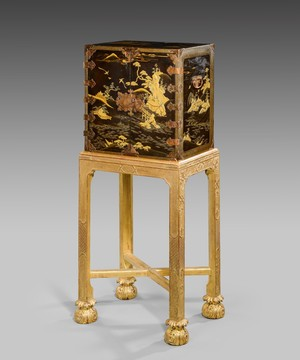 A small lacquer cabinet on stand.