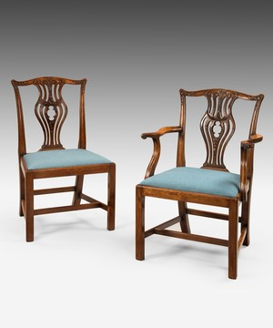 A set of 8 Chippendale dining chairs.