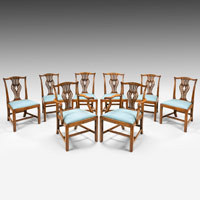 An antique set of Chippendale dining chairs.