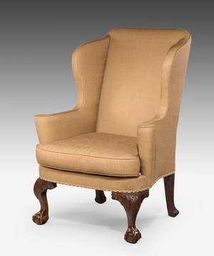 A George I walnut wing armchair.