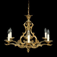 Antique brass chandelier in Louis XIV revival style.