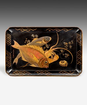 A Japanese tray decorated with fish.