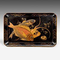 Antique tray decorated with fish.