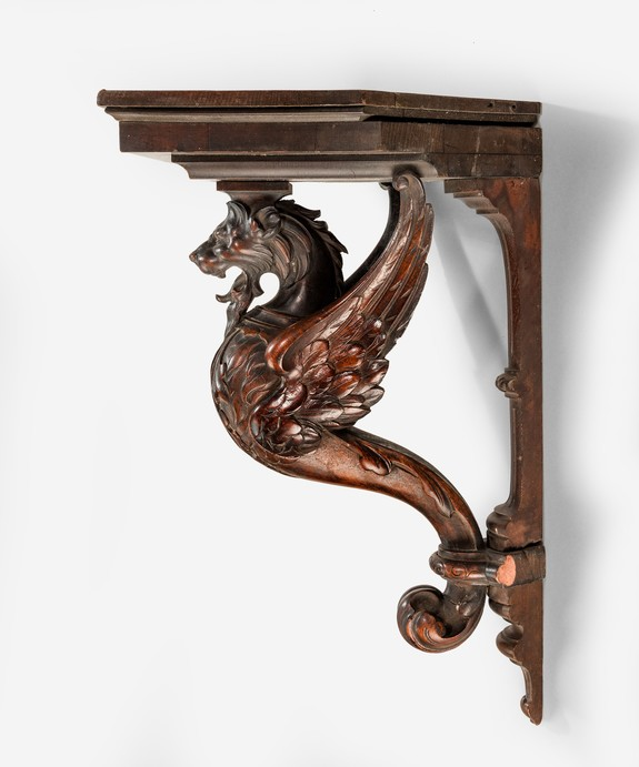 Antique corner bracket in mahogany