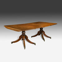 Antique dining table from the Regency period.