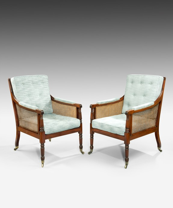 A pair of Regency bergere armchairs.