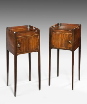 A pair of Georgian bedside tables.