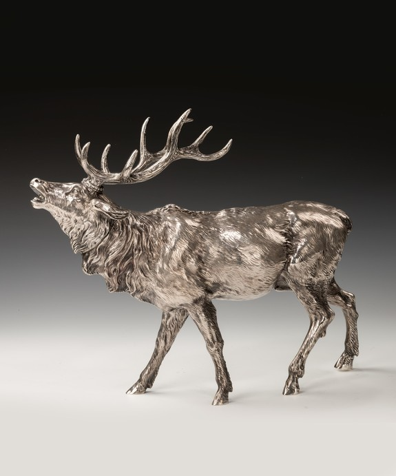 silver antique model of a stag.