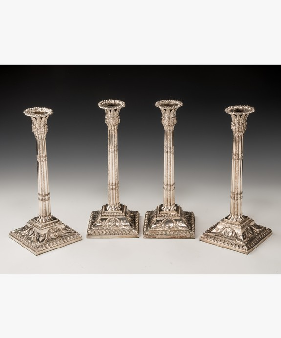 set Georgian candlesticks.