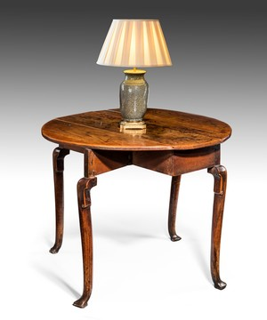 A George II elm oval table.