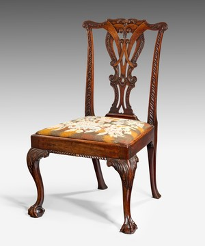 An Irish Georgian carved mahogany side chair.