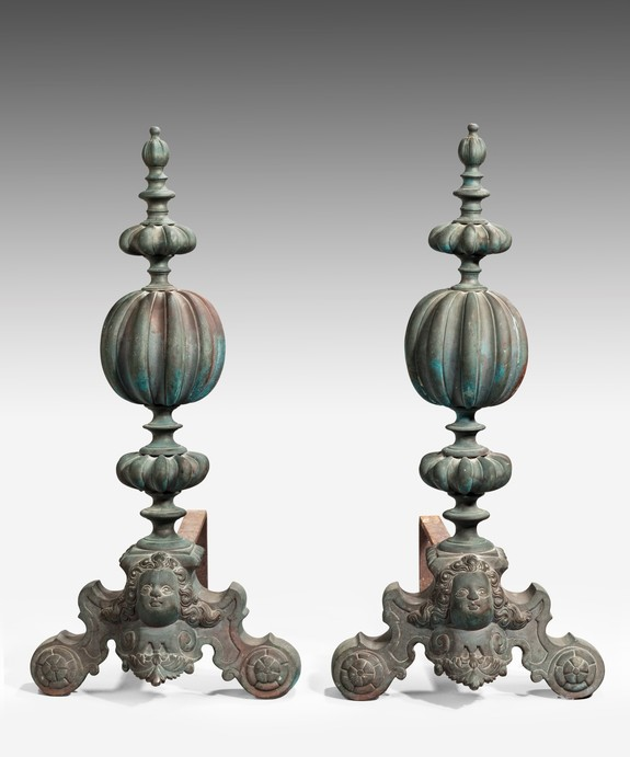 A pair of Baroque style fire dogs.
