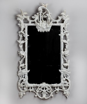 A Chippendale carved and painted mirror.