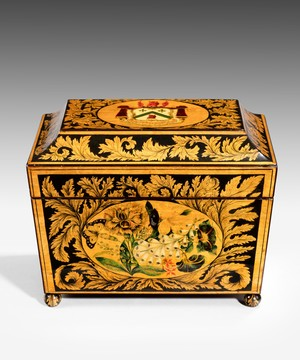 A Regency penwork tea caddy.