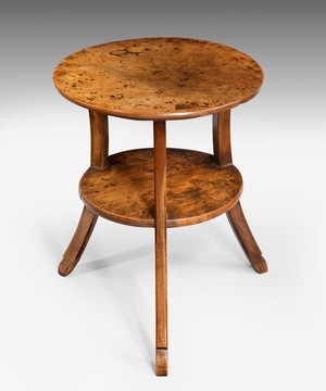 A Regency walnut and elm cricket table.