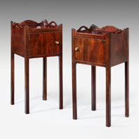 Antique pair of bedside tables.
