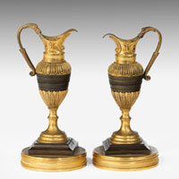 Pair antique bronze and ormolu ewers.