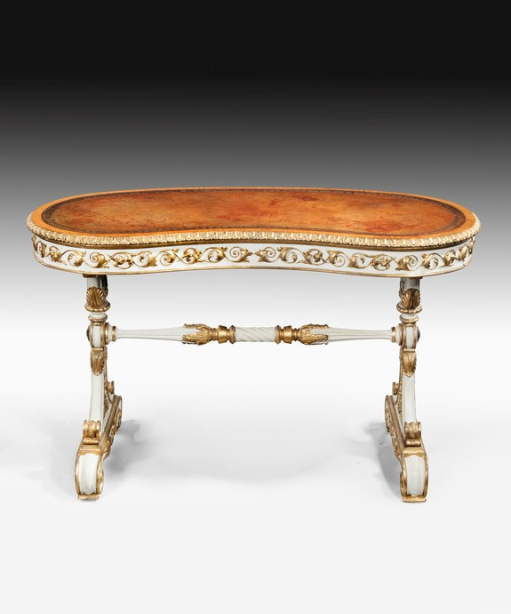 William IV writing table with carved giltwood and ivory paintwork.