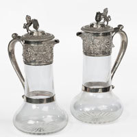 Pair of silver claret jugs.