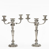 Suite of Georgian silver candlesticks and candelabra