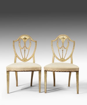Pair Sheraton white painted chairs.