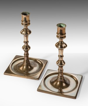 Pair of Georgian brass candlesticks.