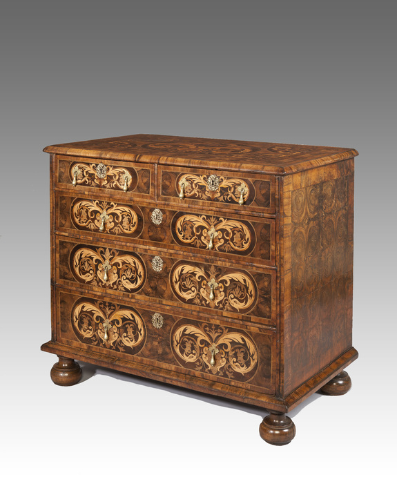 William and Mary oyster venered chest of drawers.
