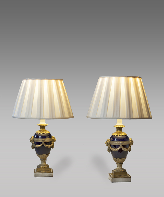 Antique pair of table lamps with blue porcelain and ormolu bases.