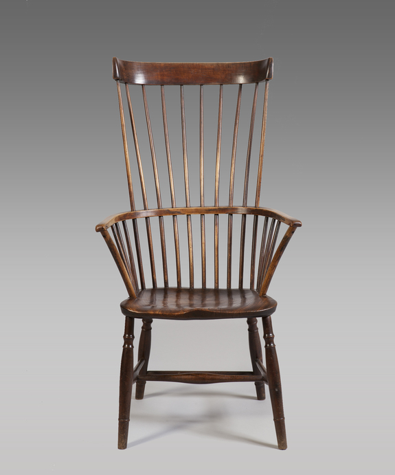 Antique fruitwood armchair in Welsh vernacular tradition.