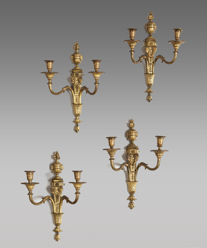 Set of four Adam style ormolu wall lights.