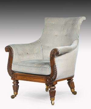Regency carved rosewood library armchair.