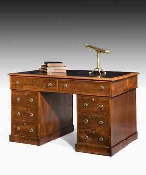 Small Nineteenth Century mahogany partners desk